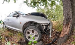 Road accident car crash againsta a tree on a city road