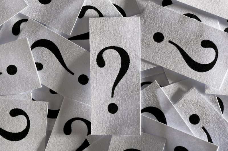 question marks on card