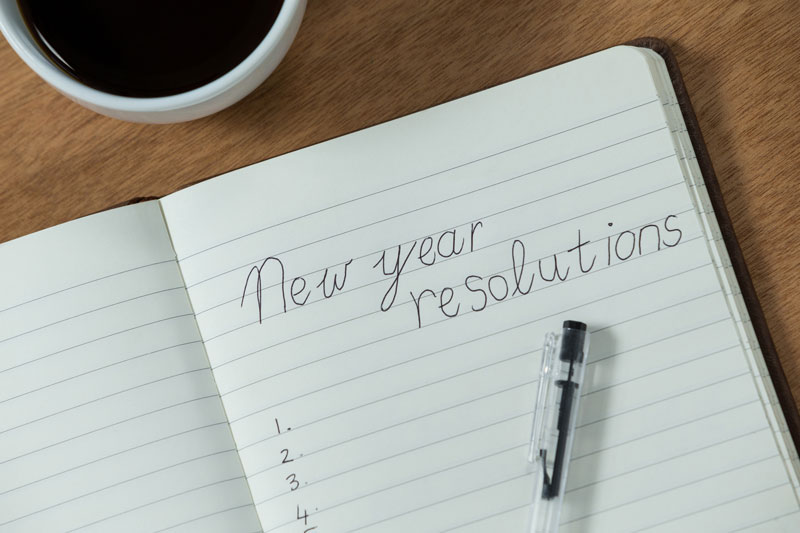 a list of new year's resolutions on paper